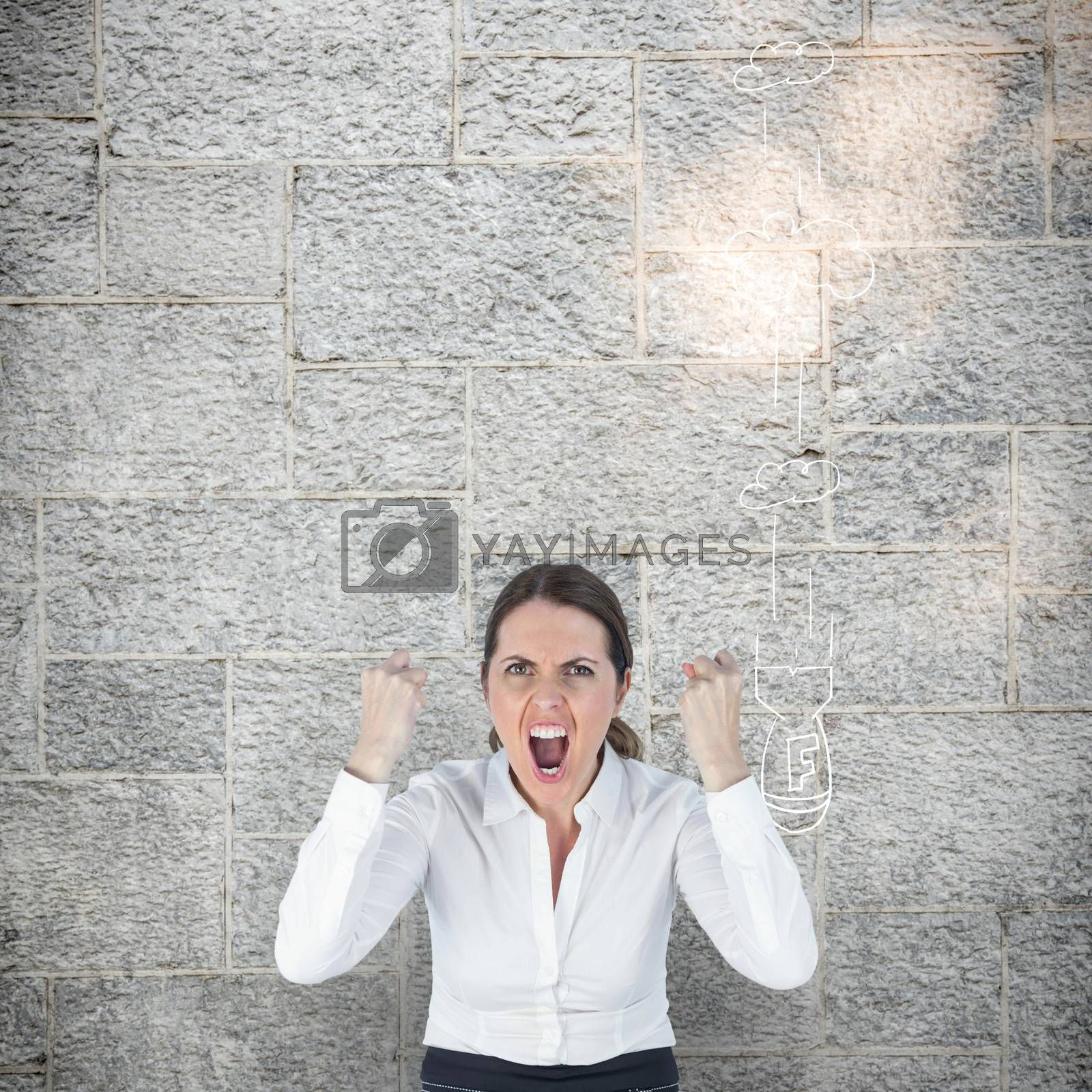 Portrait of screaming businesswoman clanching fists against grey