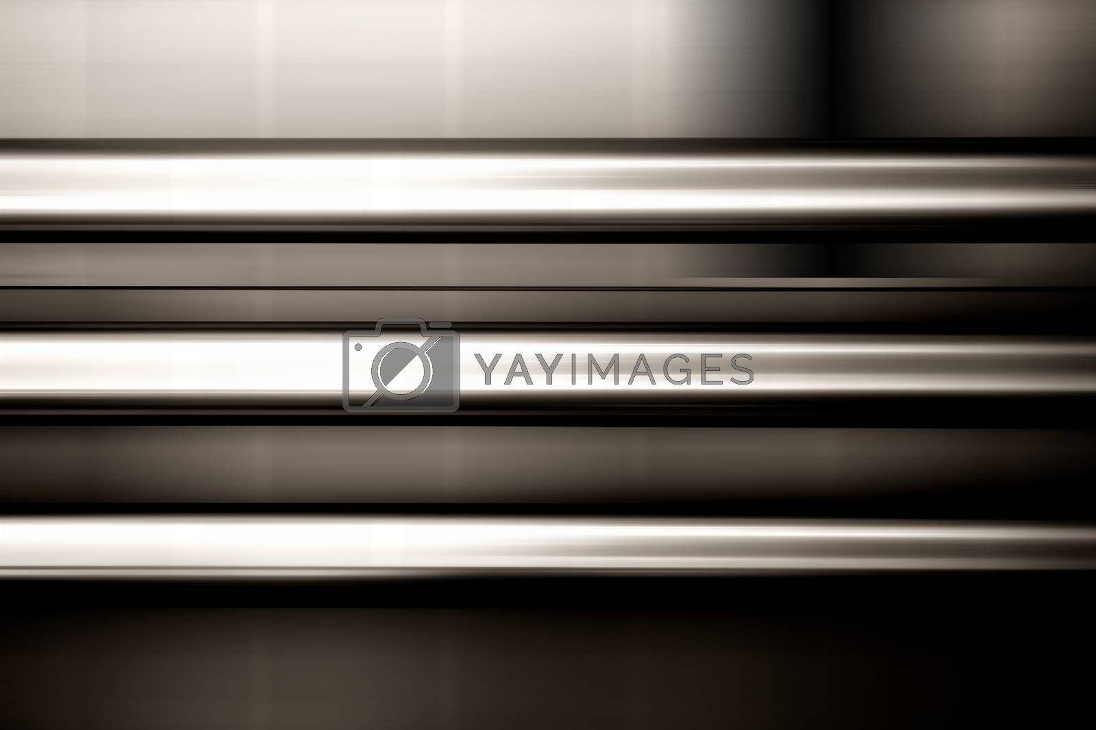 Three parallel-mounted stainless steel pipes at a blurred facade.