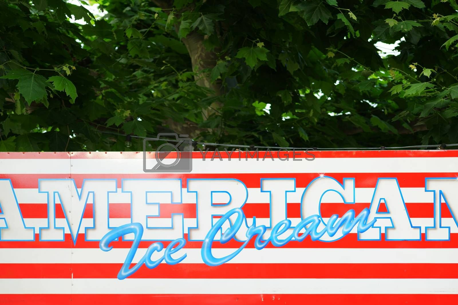 The upper edge of an ice seller for American ice cream in the colors of the American flag.