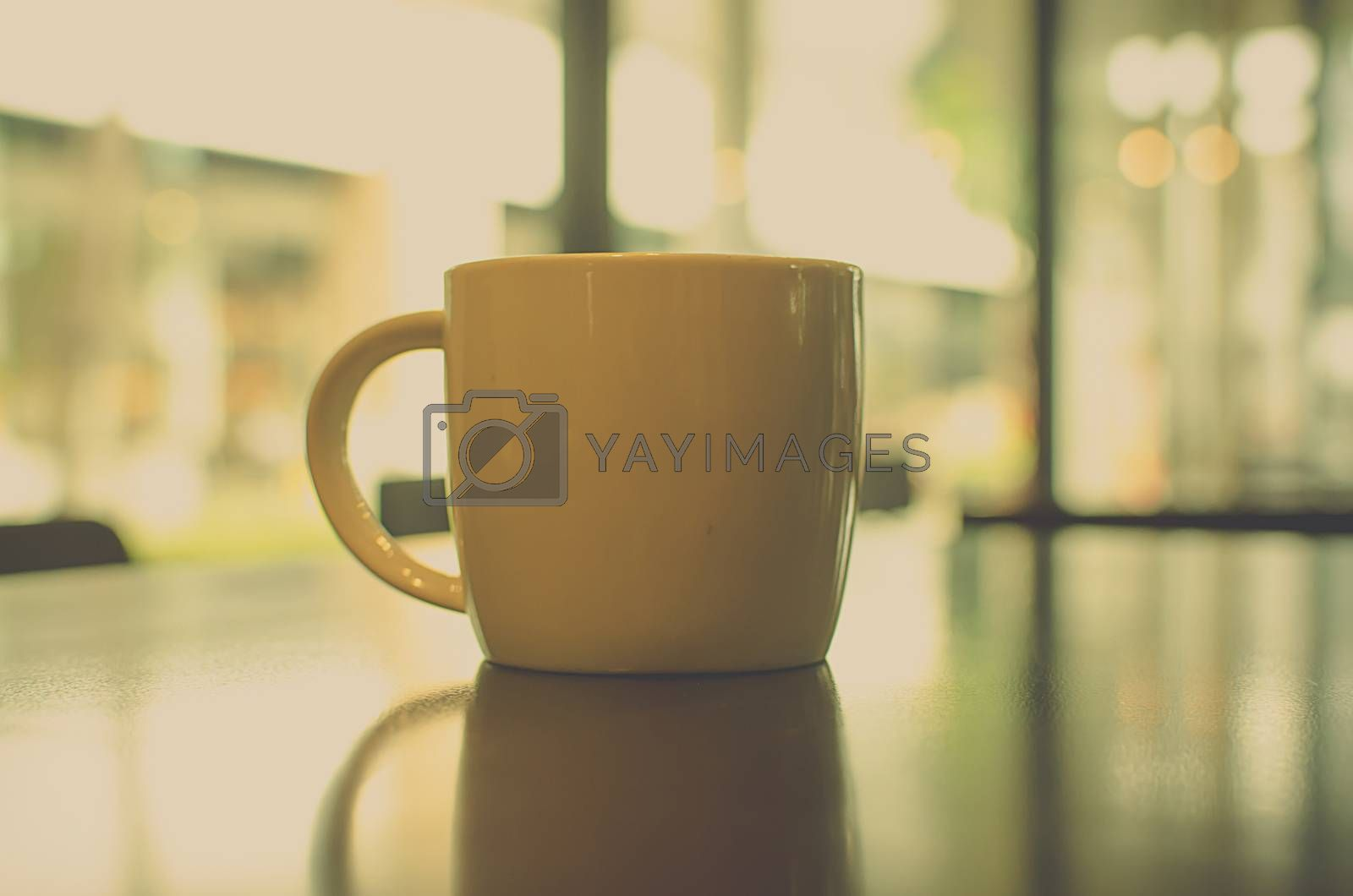 Coffee cup in coffee shop - vintage style