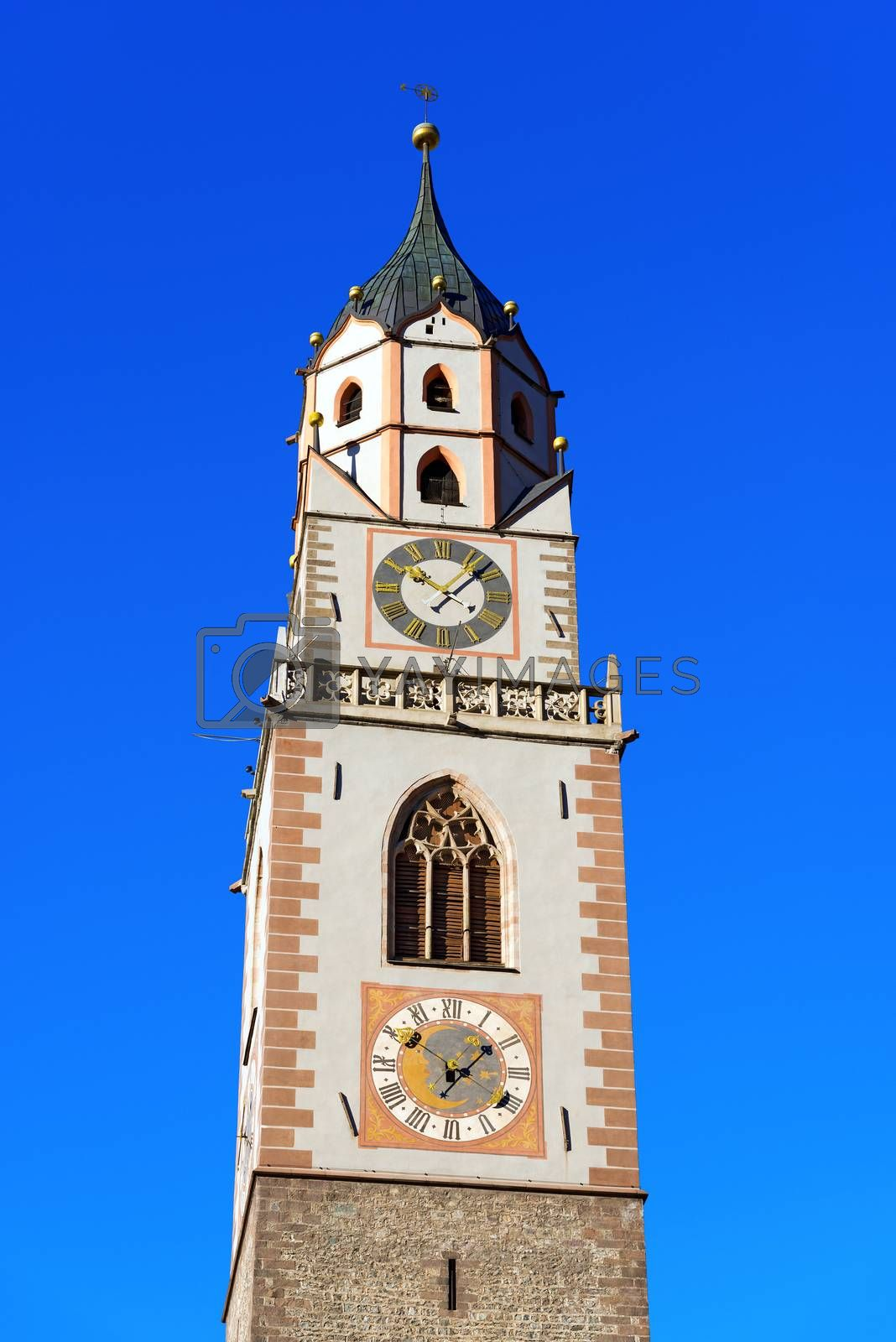 Detail of the bell tower of the Cathedral of St. Nicholas (1302-1465) in Merano, Bolzano, Trentino Alto Adige, Italy