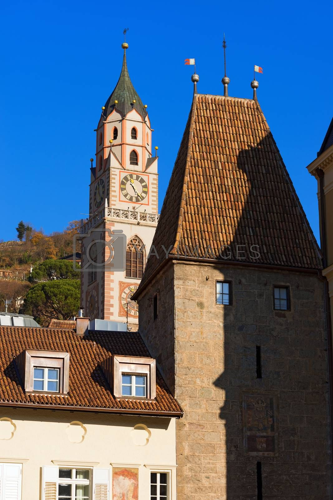 Detail of the bell tower of the Cathedral and Porta Bolzano (XIV century) in Merano, Bolzano, Trentino Alto Adige, Italy