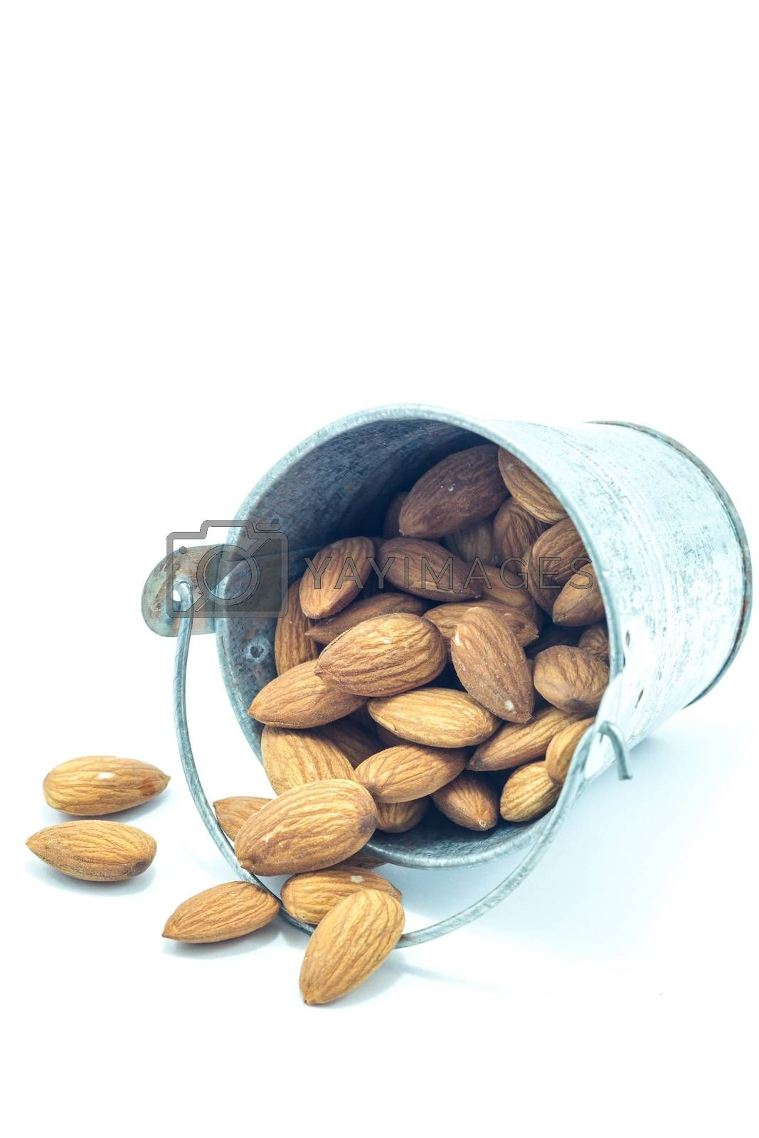 Almonds in bucket isolated on white background, stock photo
