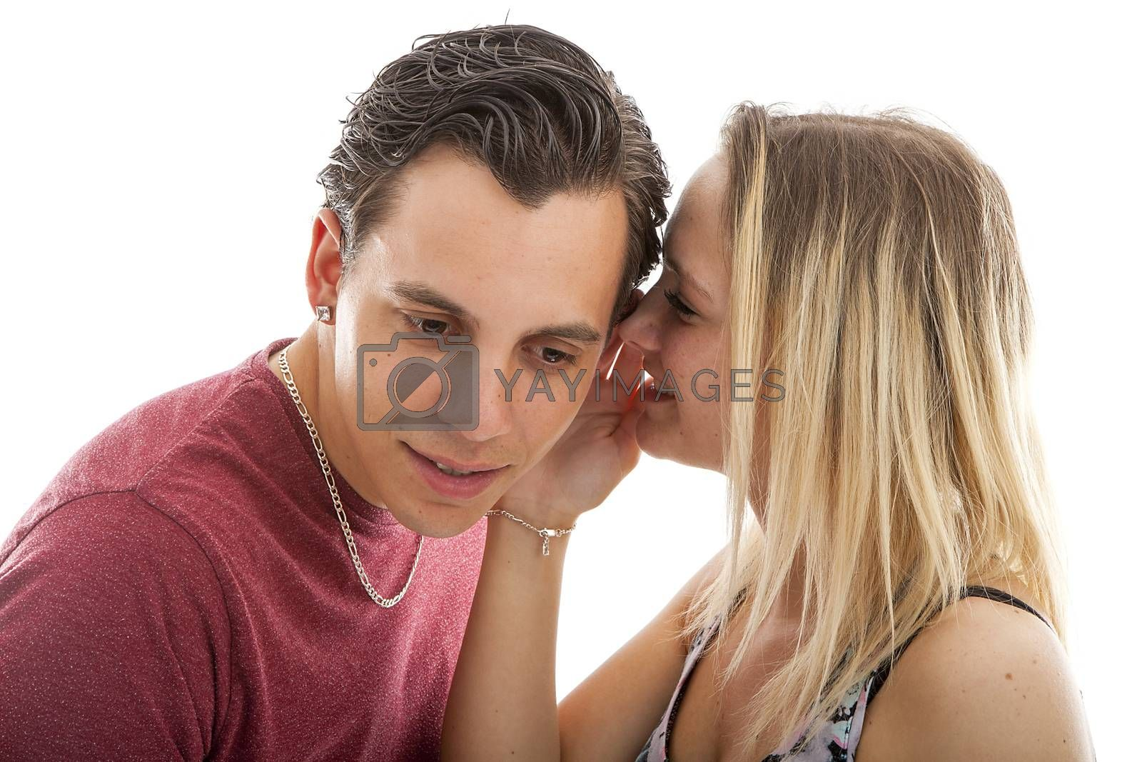 girl is whispering in ear of boyfriend isolated on white background