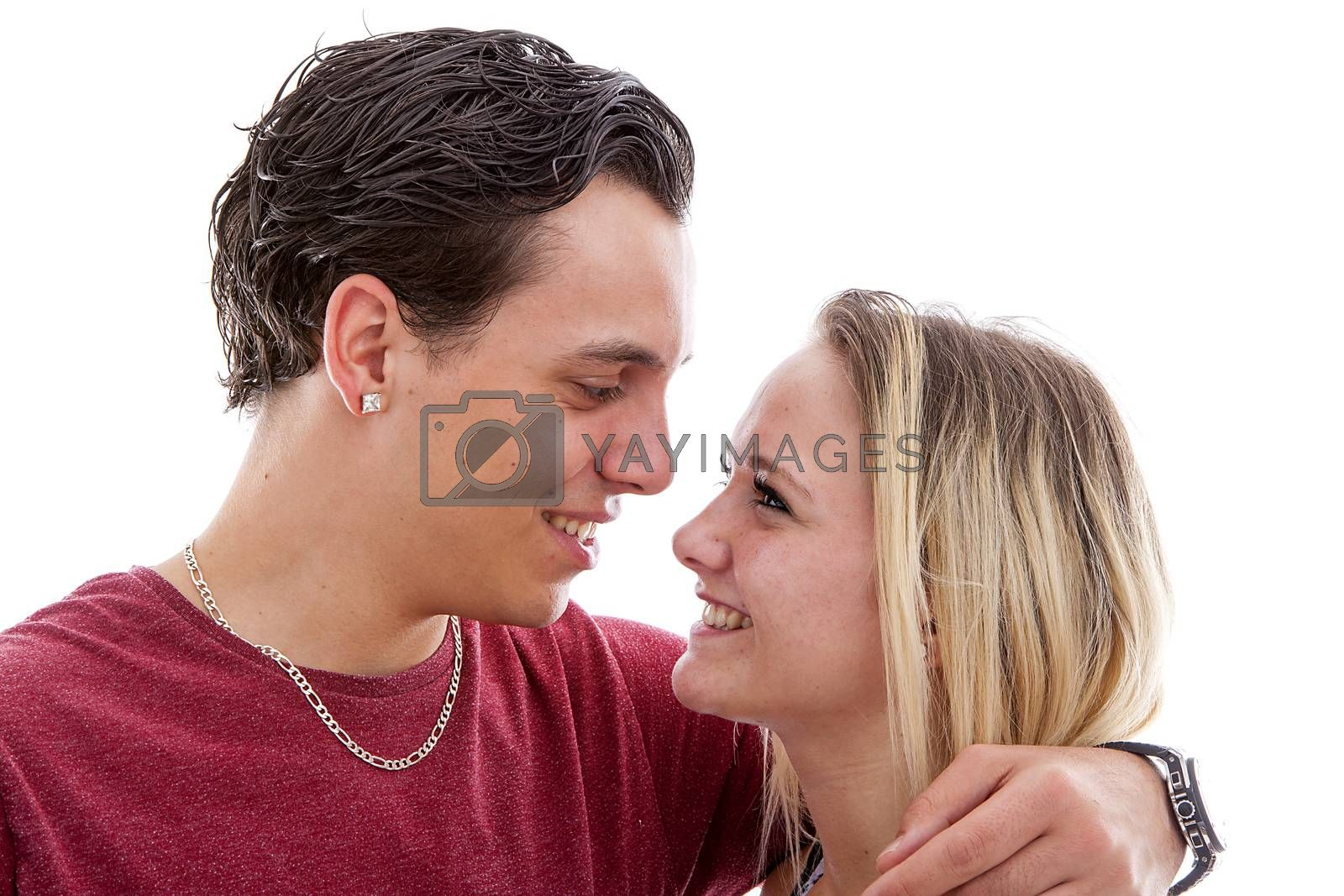 Young couple in love over white background looking at each other