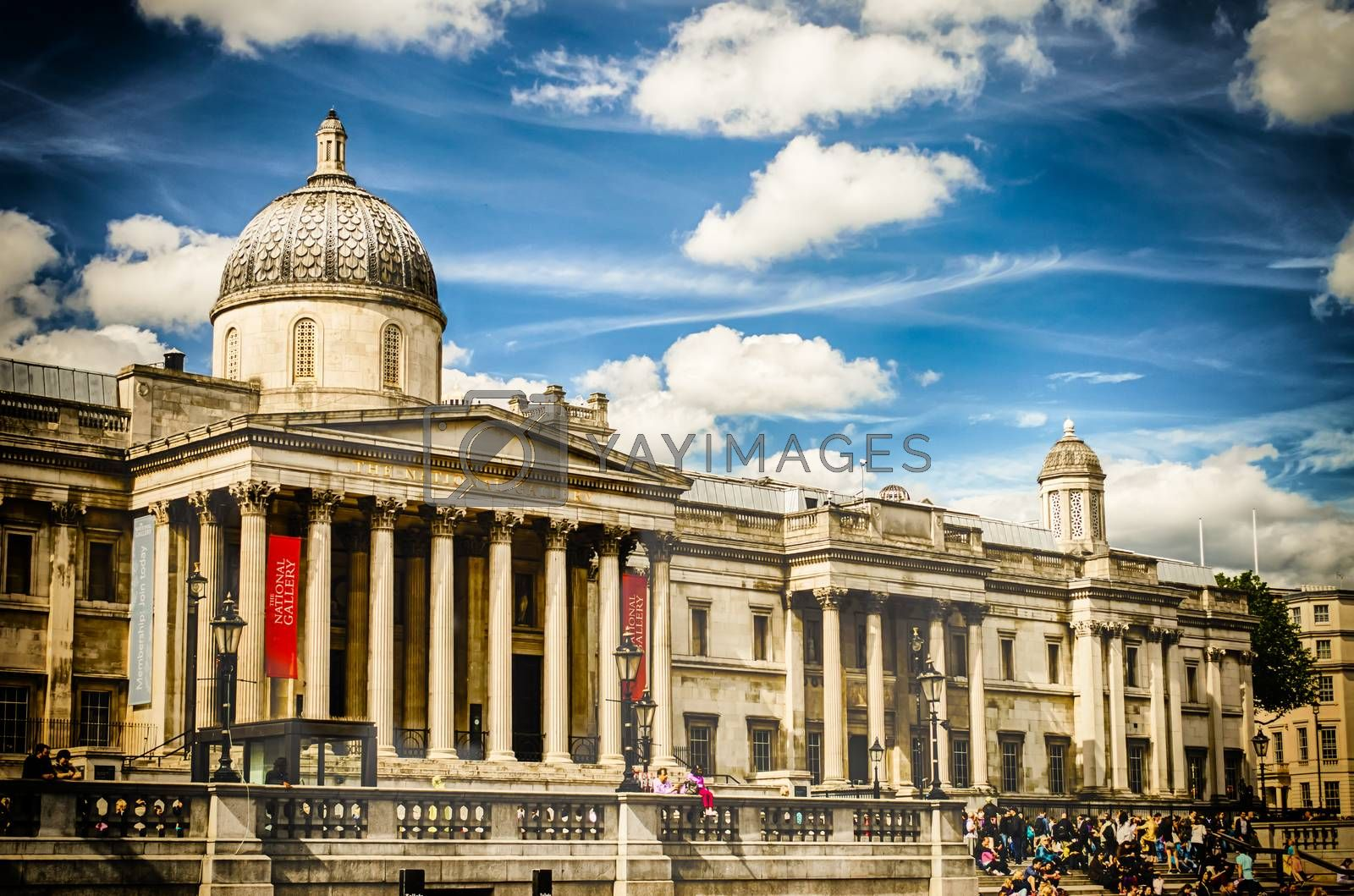 LONDON - MAY 28: Tourists in Trafalgar Square outside the National Gallery, May 28, 2015 in London. Founded in 1824, the National Gallery is one of the most visited museum in the world