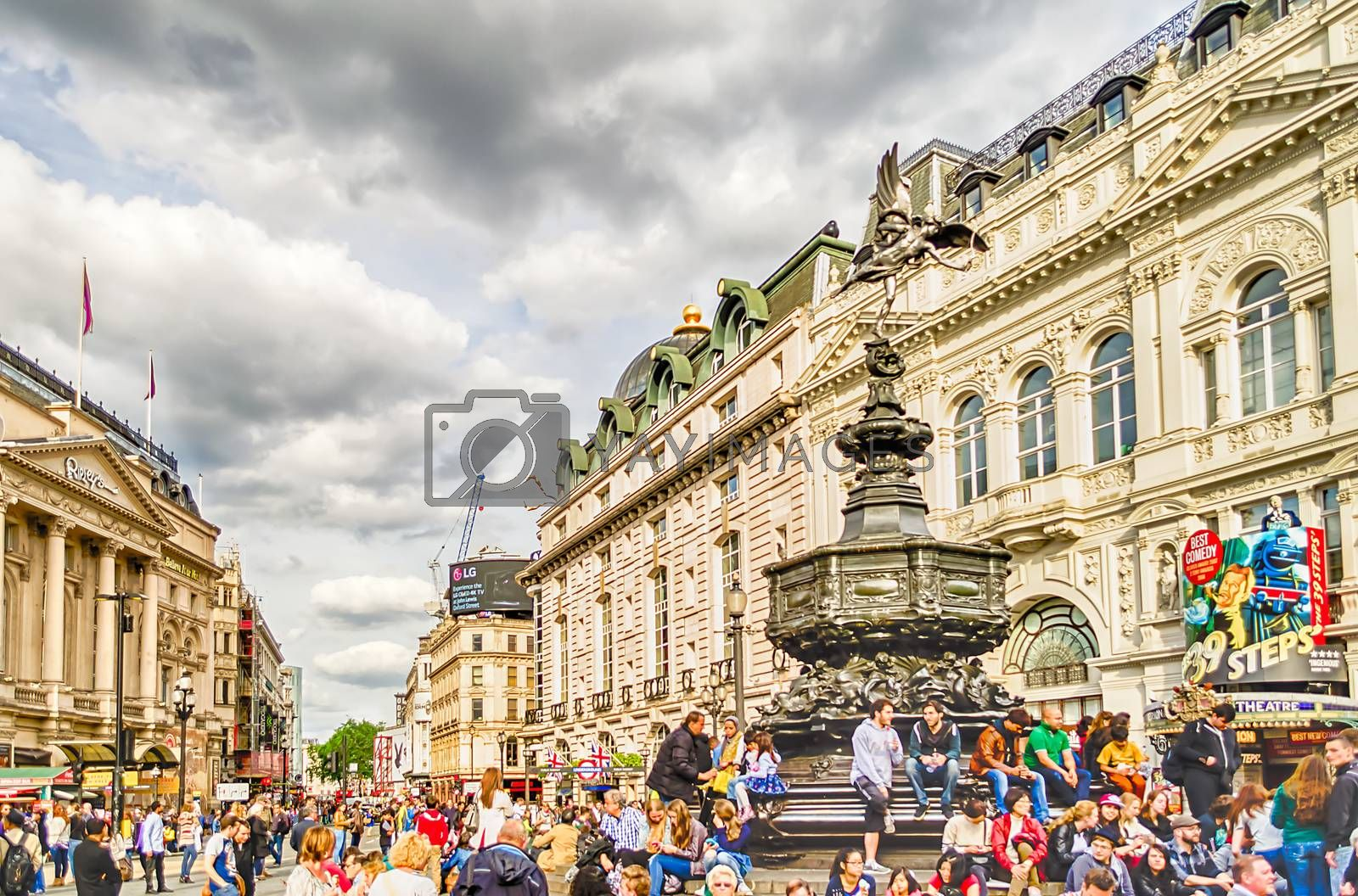 LONDON - MAY 28:Tourists gather around the statue of Eros at Picadilly Circus May 28, 2015 in London. The Circus is close to major shopping and entertainment areas in the West End