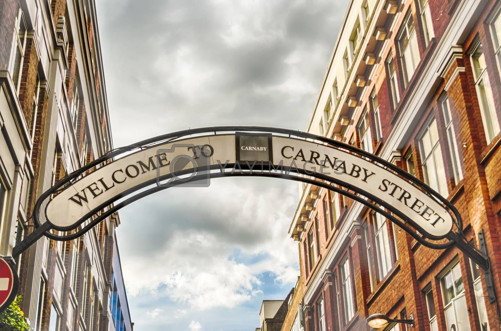 LONDON - MAY 28: Carnaby Street sign in London, UK on May 28, 2015. Carnaby Street is an iconic pedestrianised shopping street associated with swinging London of the 1960s.