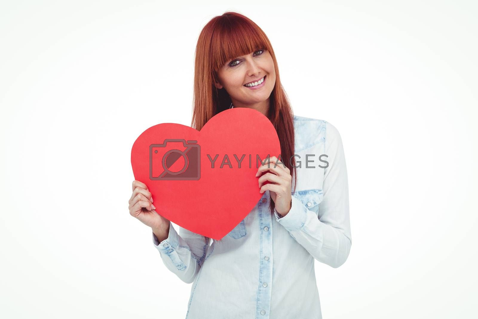 Attractive hipster woman behind a red heart against white background