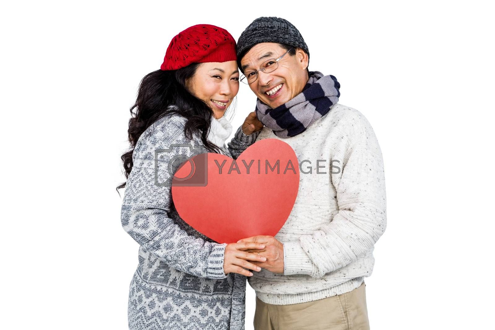 Portrait of happy couple with balloon against white background