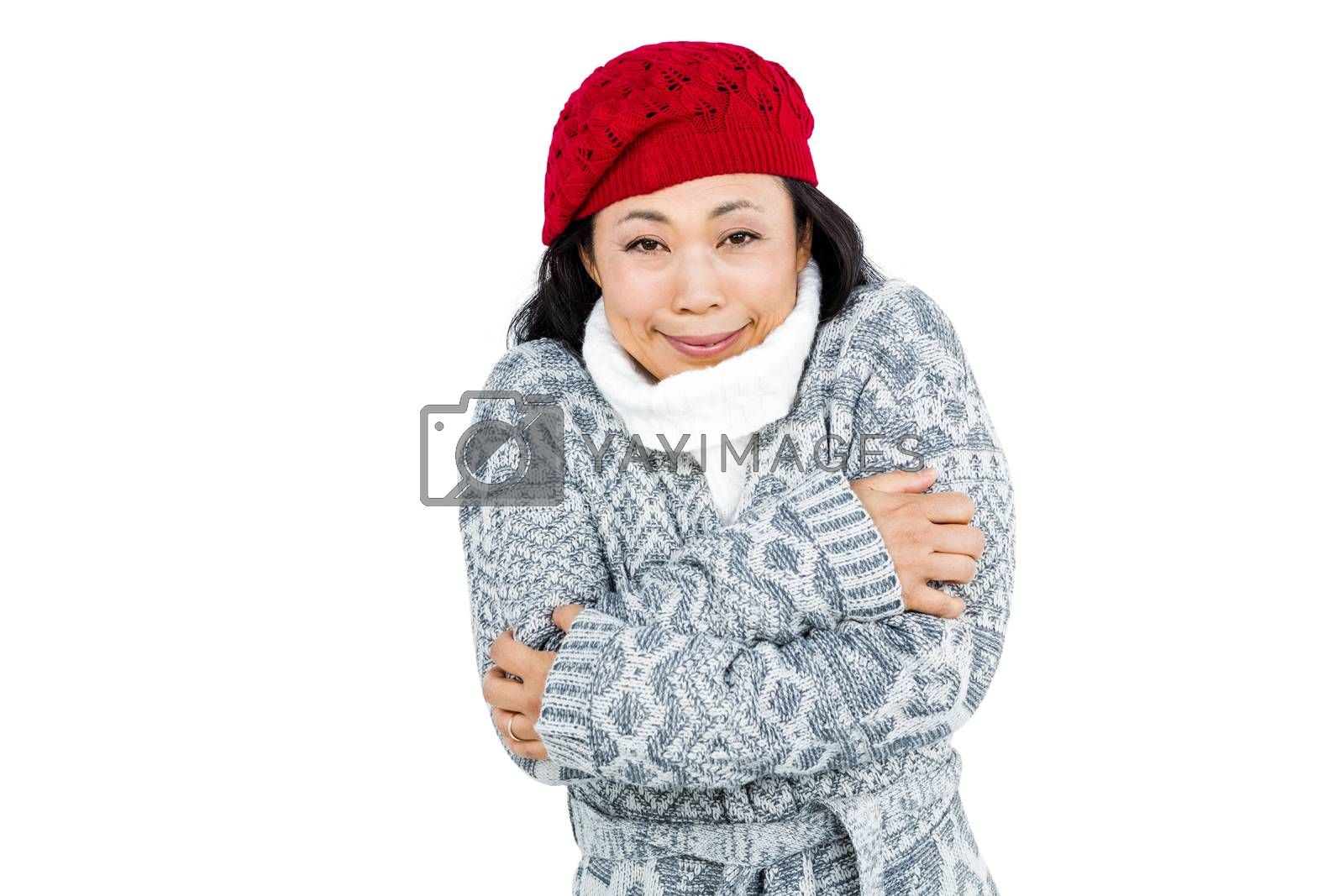 Portrait of woman in cold weather against white background