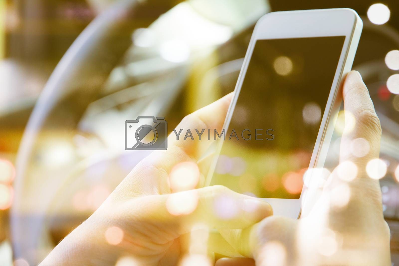 image of people sitting in the car using smart phone double exposure and blurred view of car on street at night