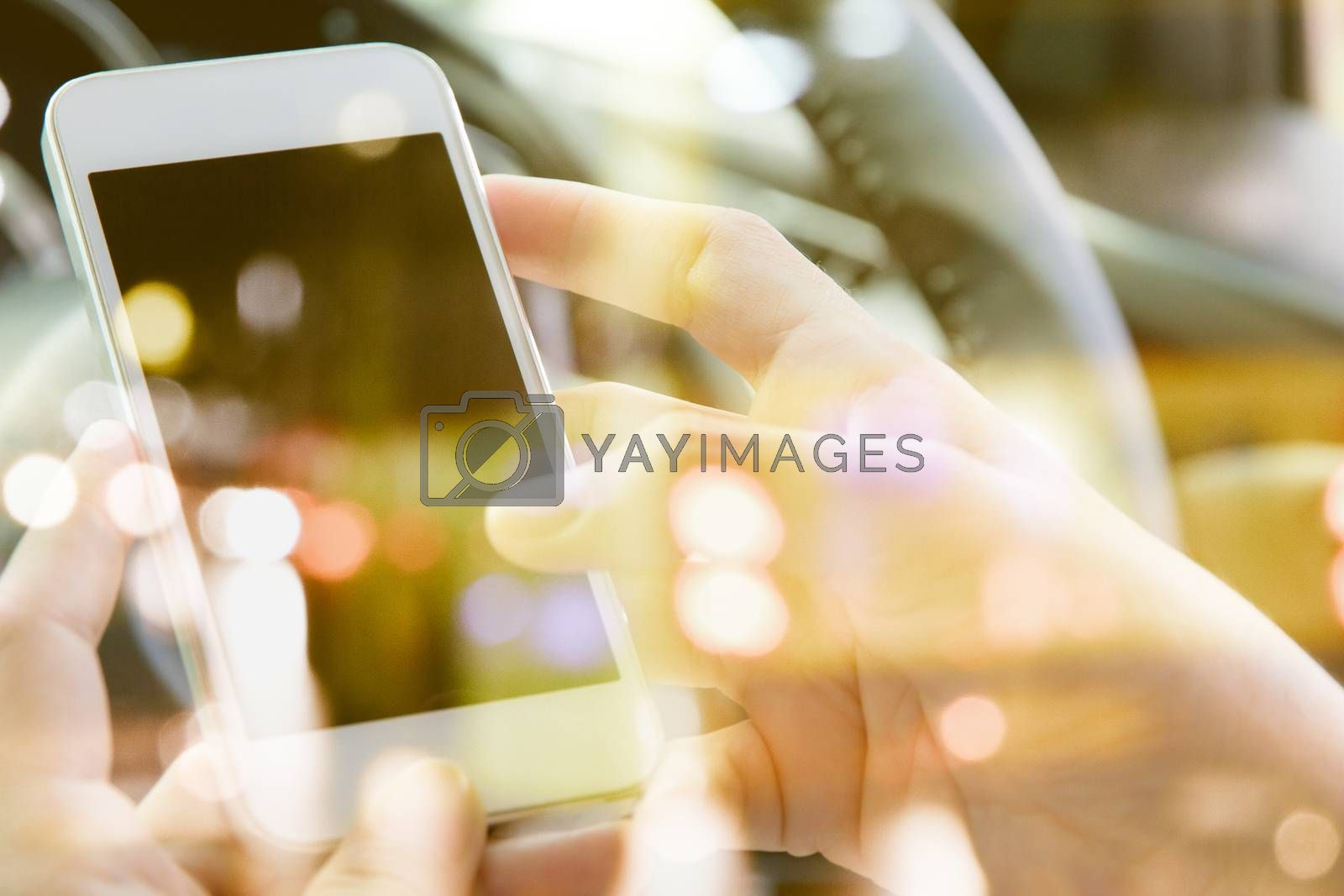 communication technology concept. image of people sitting in the car using smart phone double exposure and blurred view of car on street at night