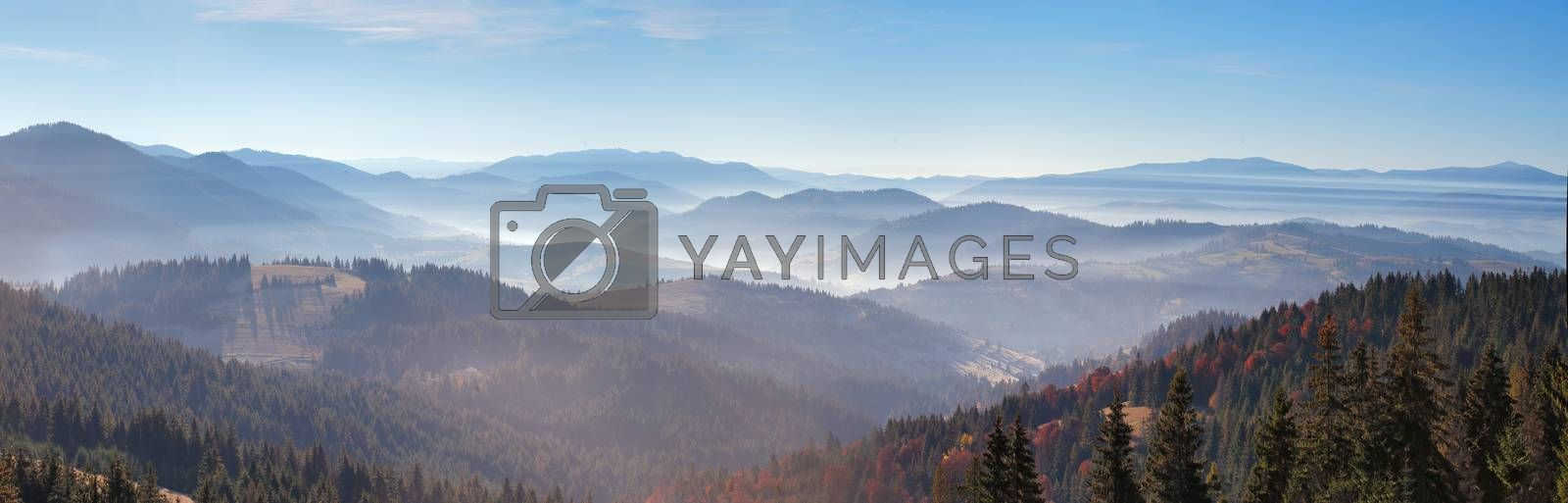 Morning mist in mountains. Sunrise and autumn mist over the hills. Ukraine Carpathians