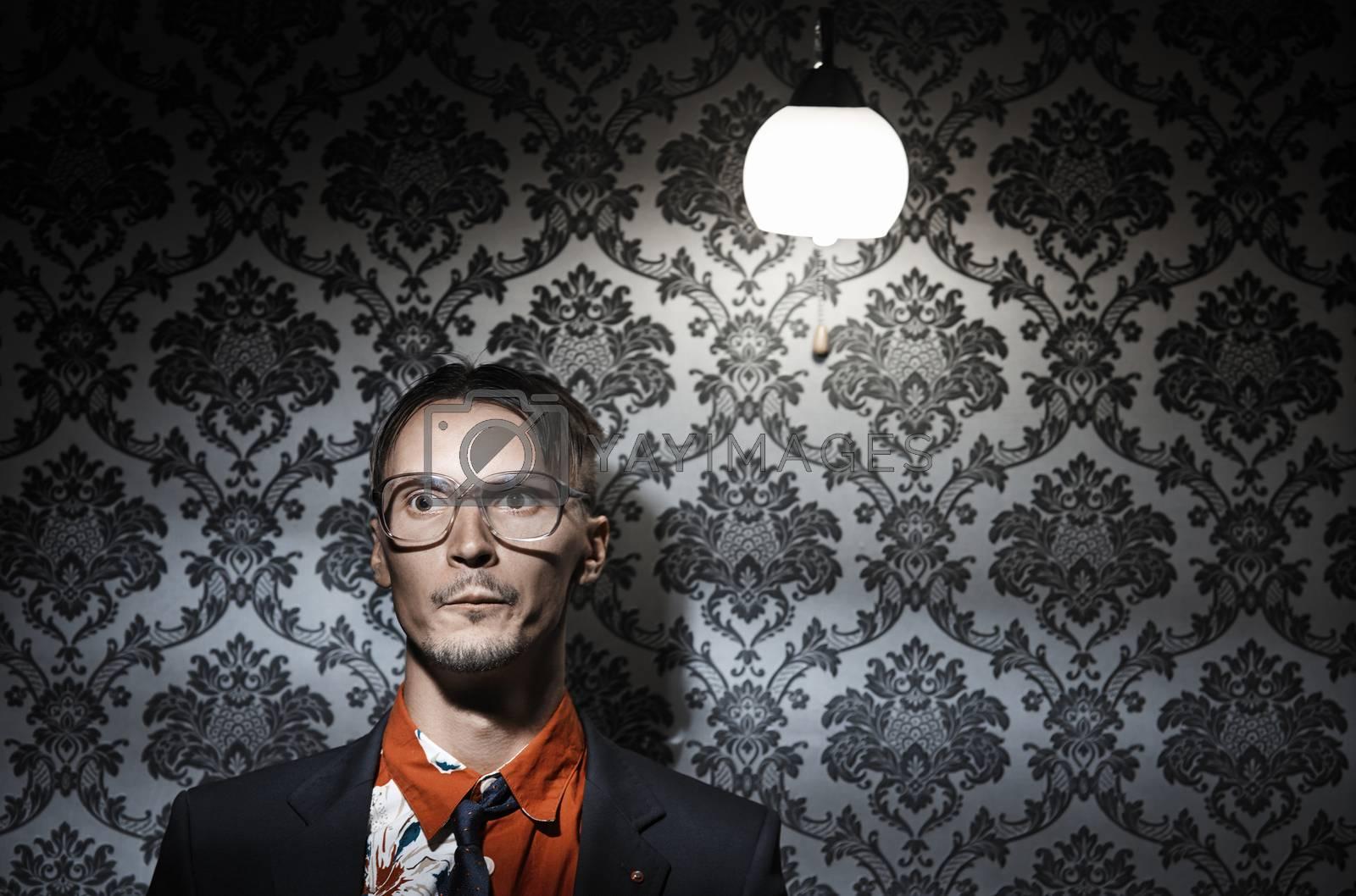 Crazy maniac man at the dark wall . Horizontal photo