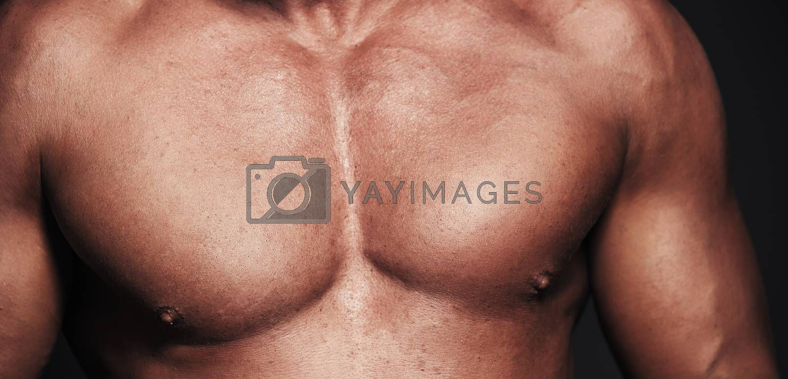 Close-up view on a muscular body. Topless man