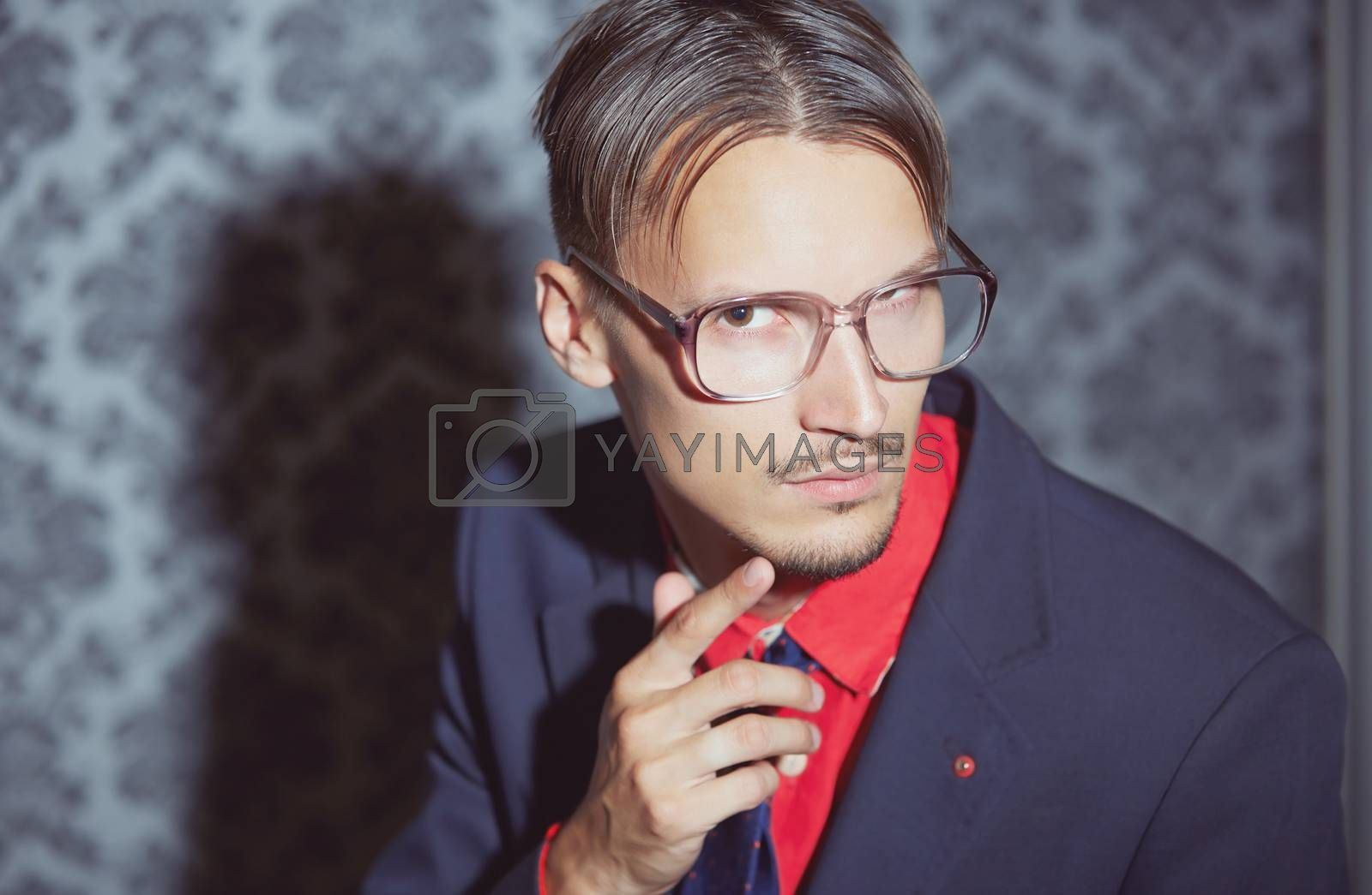 Hipster businessman in glasses. Horizontal photo
