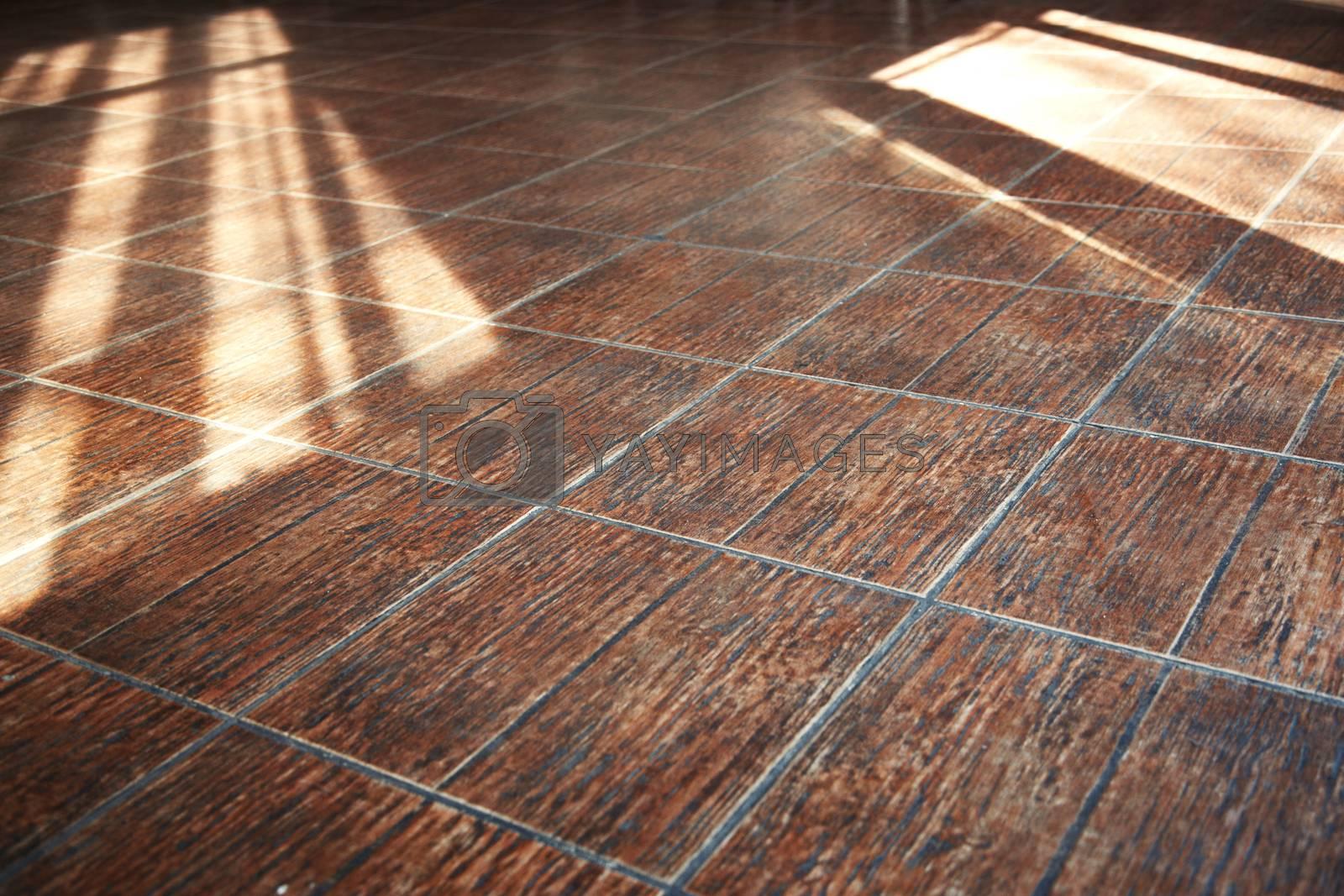 Stony floor with sunlight shadows. Horizontal photo