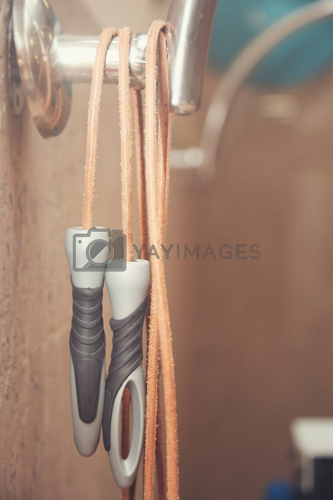 Jump rope in the gym class. Close-up vertical photo