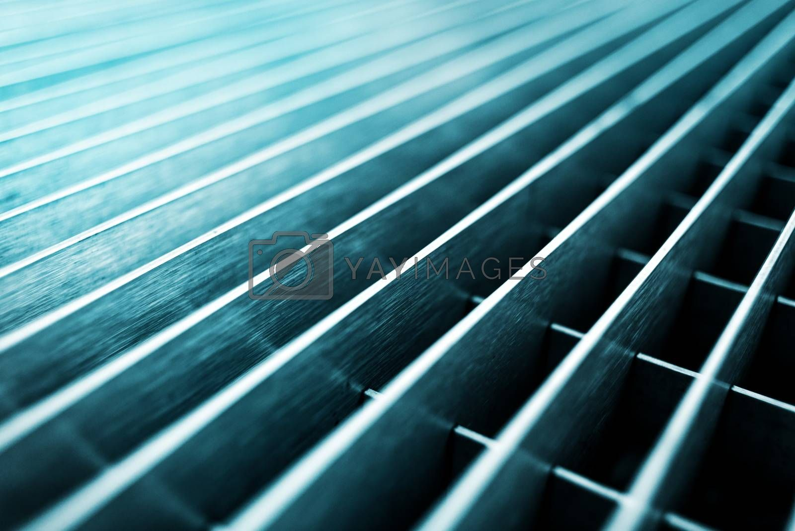 Abstract metal grid background, selective focus with shallow depth of field