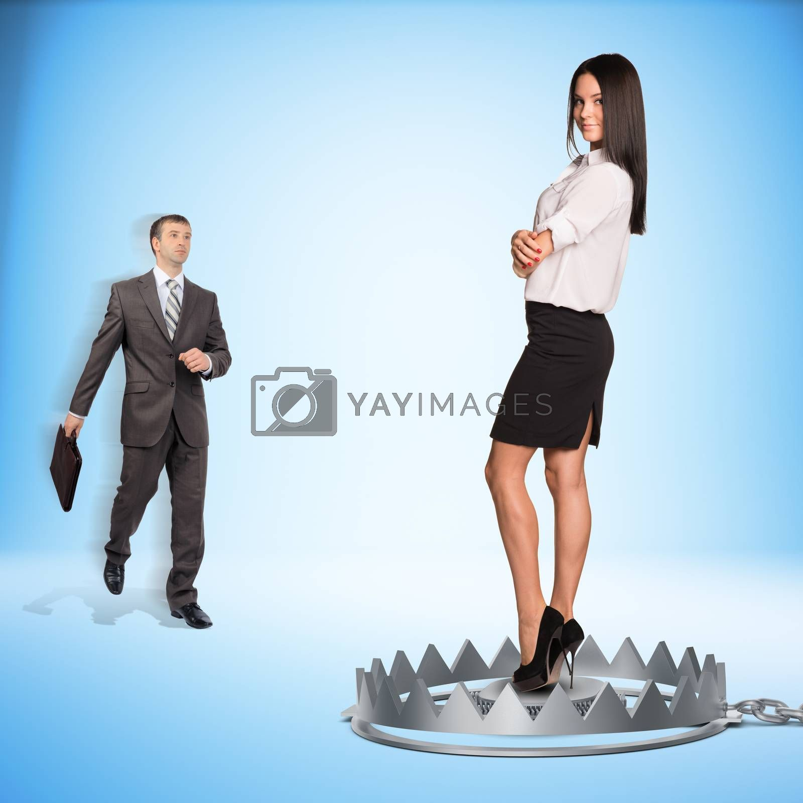 Businessman with lady in bear trap on blue background