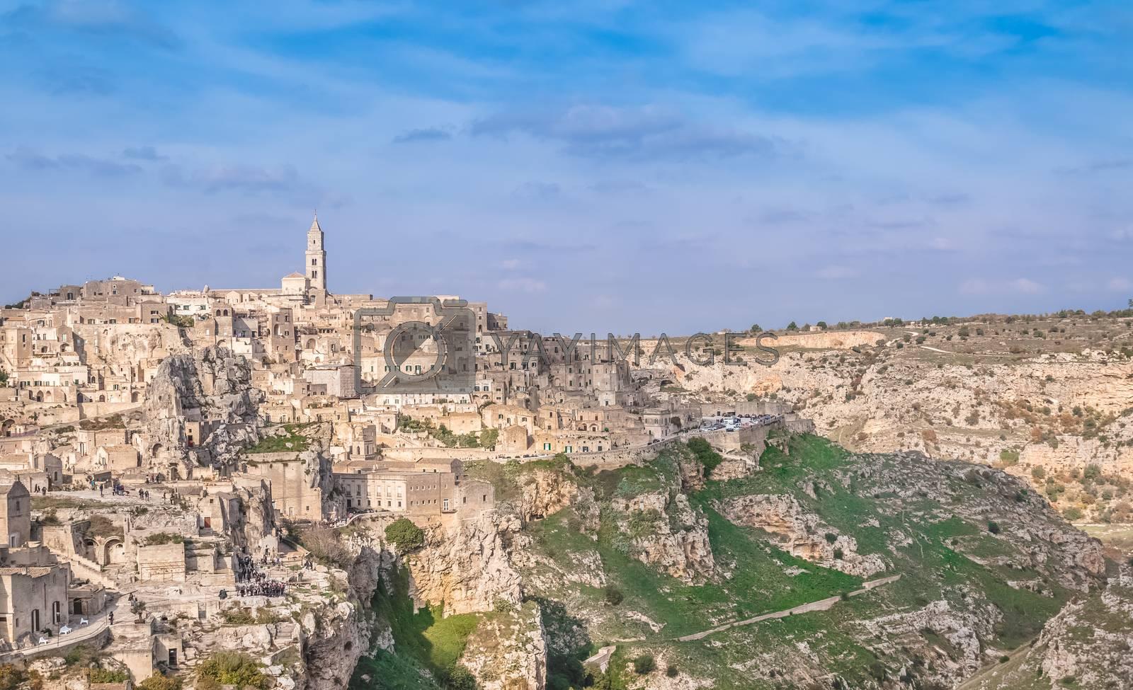 panoramic view of typical stones (Sassi di Matera) and church near gravina of Matera UNESCO European Capital of Culture 2019 on blue sky. Basilicata, Italy