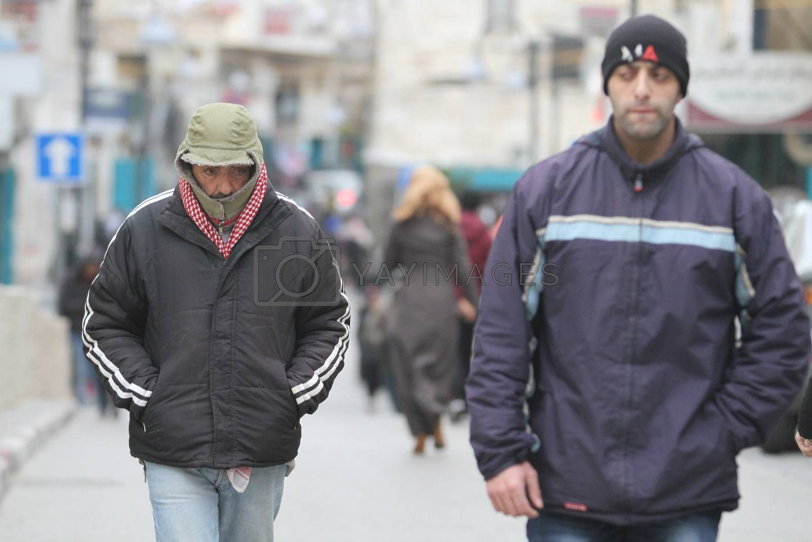 WEST BANK, Bethlehem: Men walk on a street, in the Palestinian city of Bethlehem, on January 19, 2016, as a sandstorm hits Israel and West Bank, causing air pollution. A low-pressure system over the Mediterranean has driven the dust northeast from Egypt and the Sinai Peninsula.