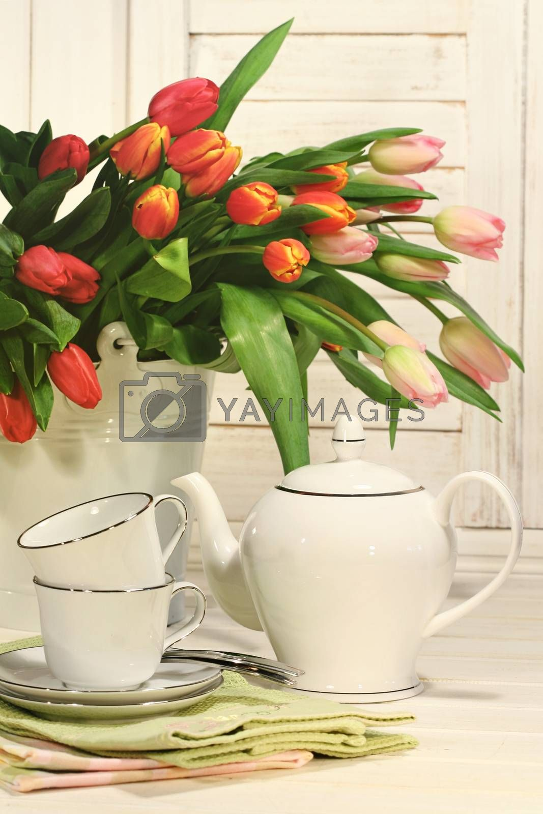Tea set with tulip flowers for Easter