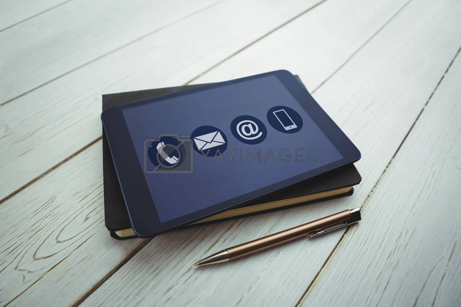 Communication apps against view of a book and tablet lying on desk