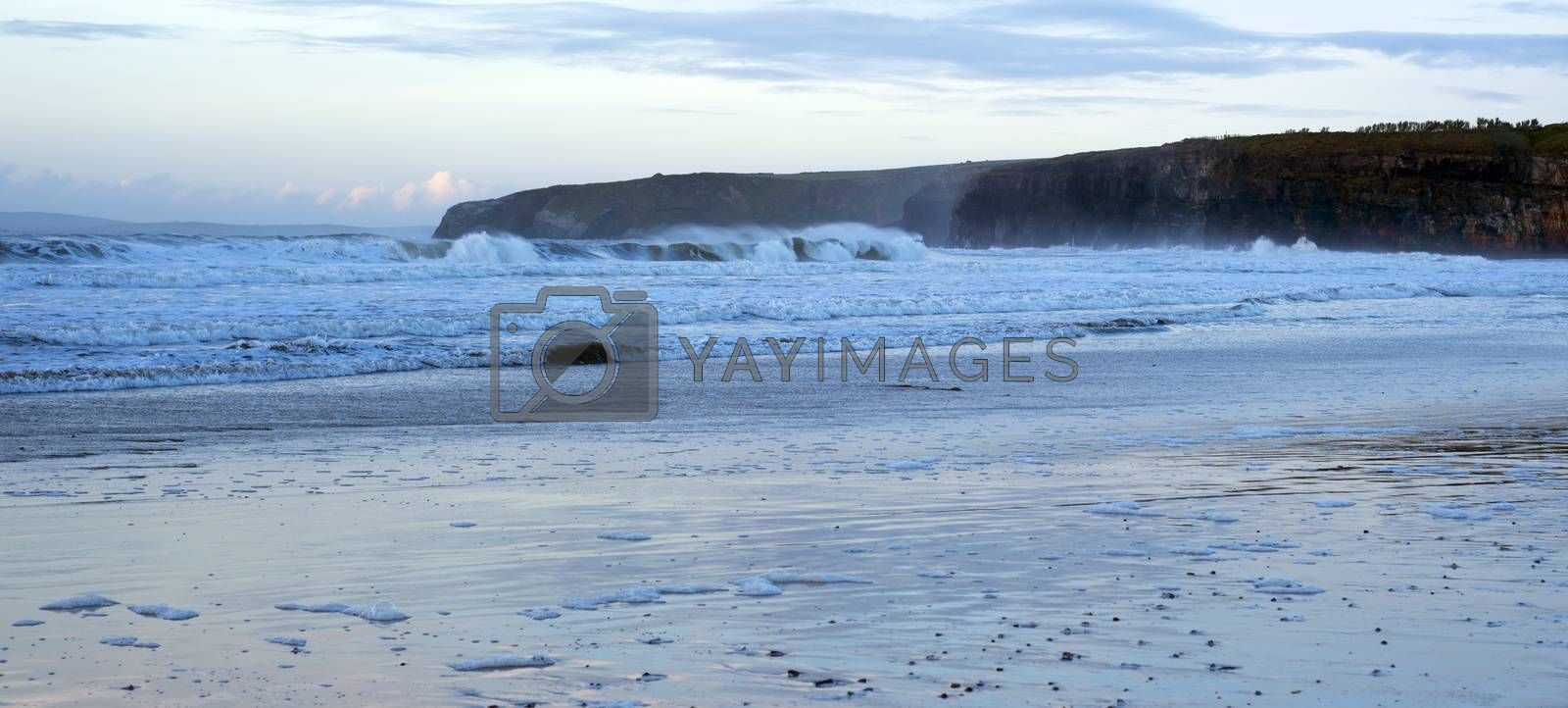 Royalty free image of blue winter waves crashing by morrbyte