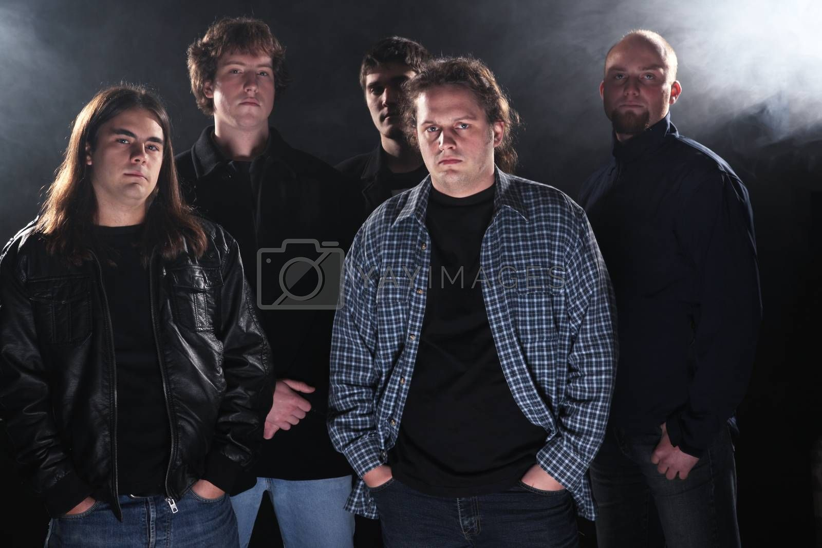 Group portrait of a rock band.