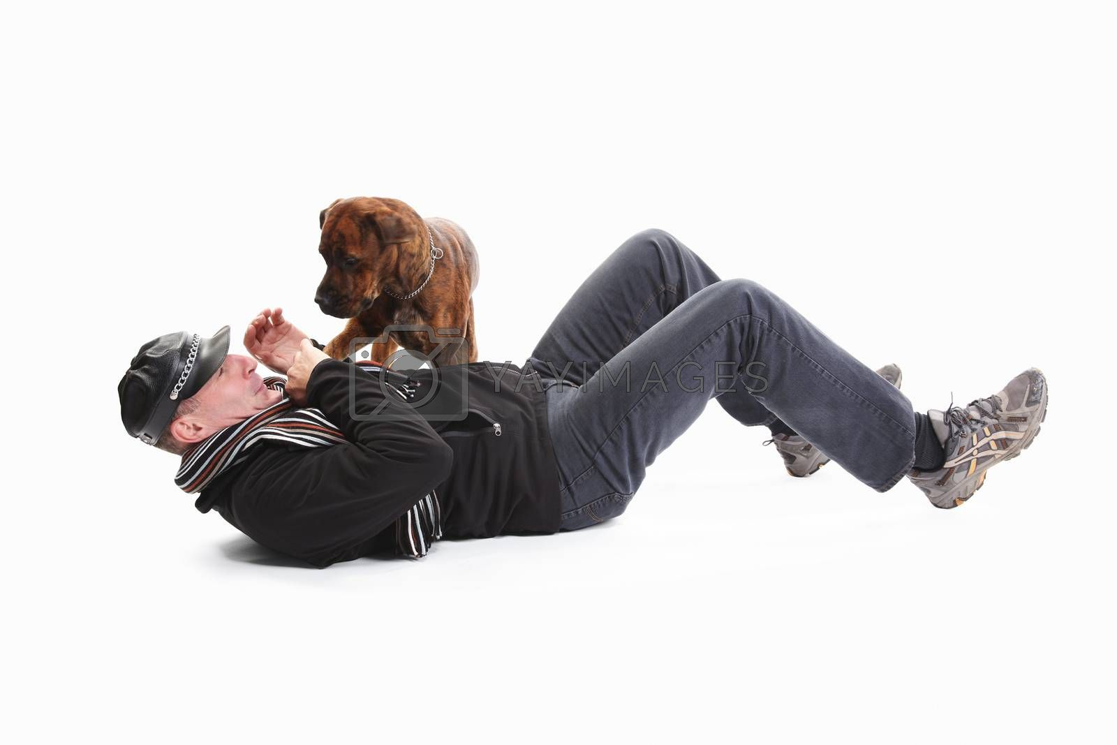 Mature Man Lying On Back With Dog Over White Background
