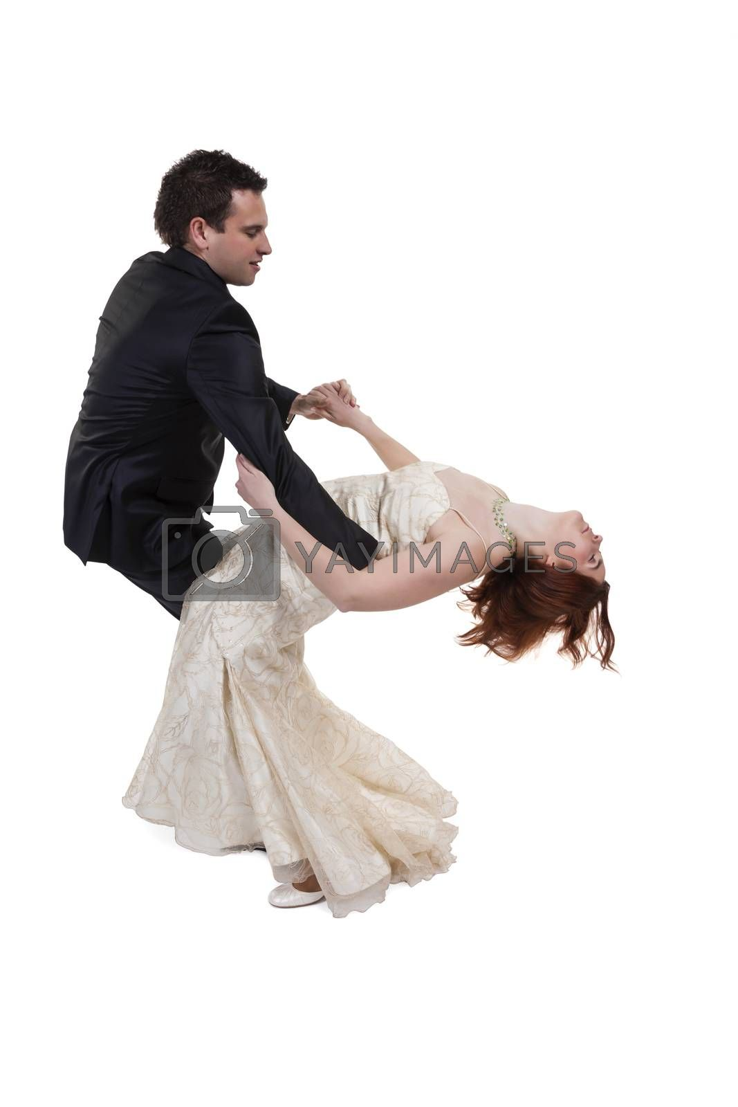 Young Married Couple Dancing Over White Background
