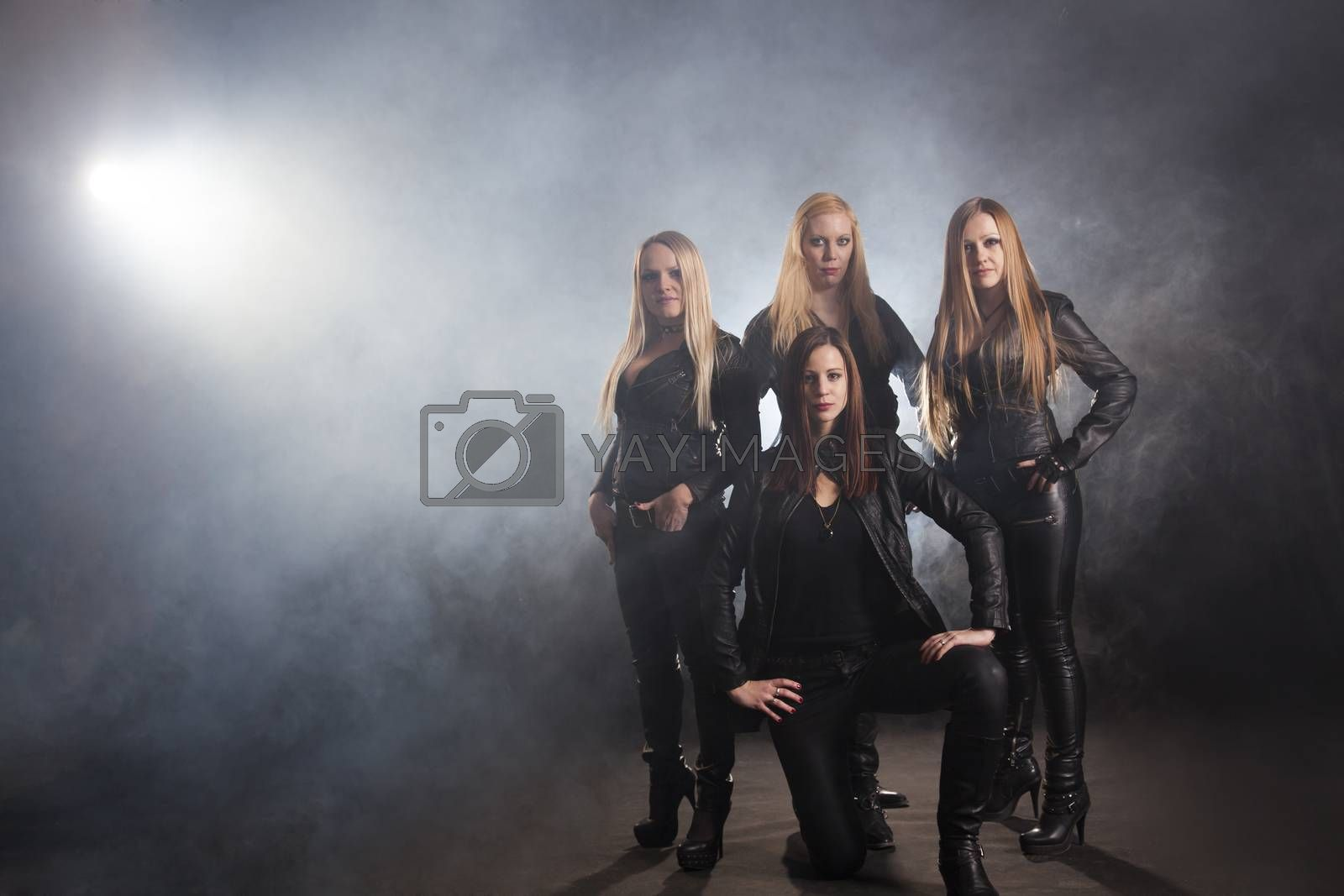 Group Of Female Friends Standing In Smoke; Indoors