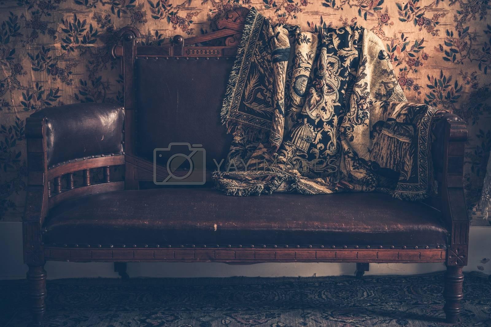 Vintage Leather Sofa with Vintage Blanket.
