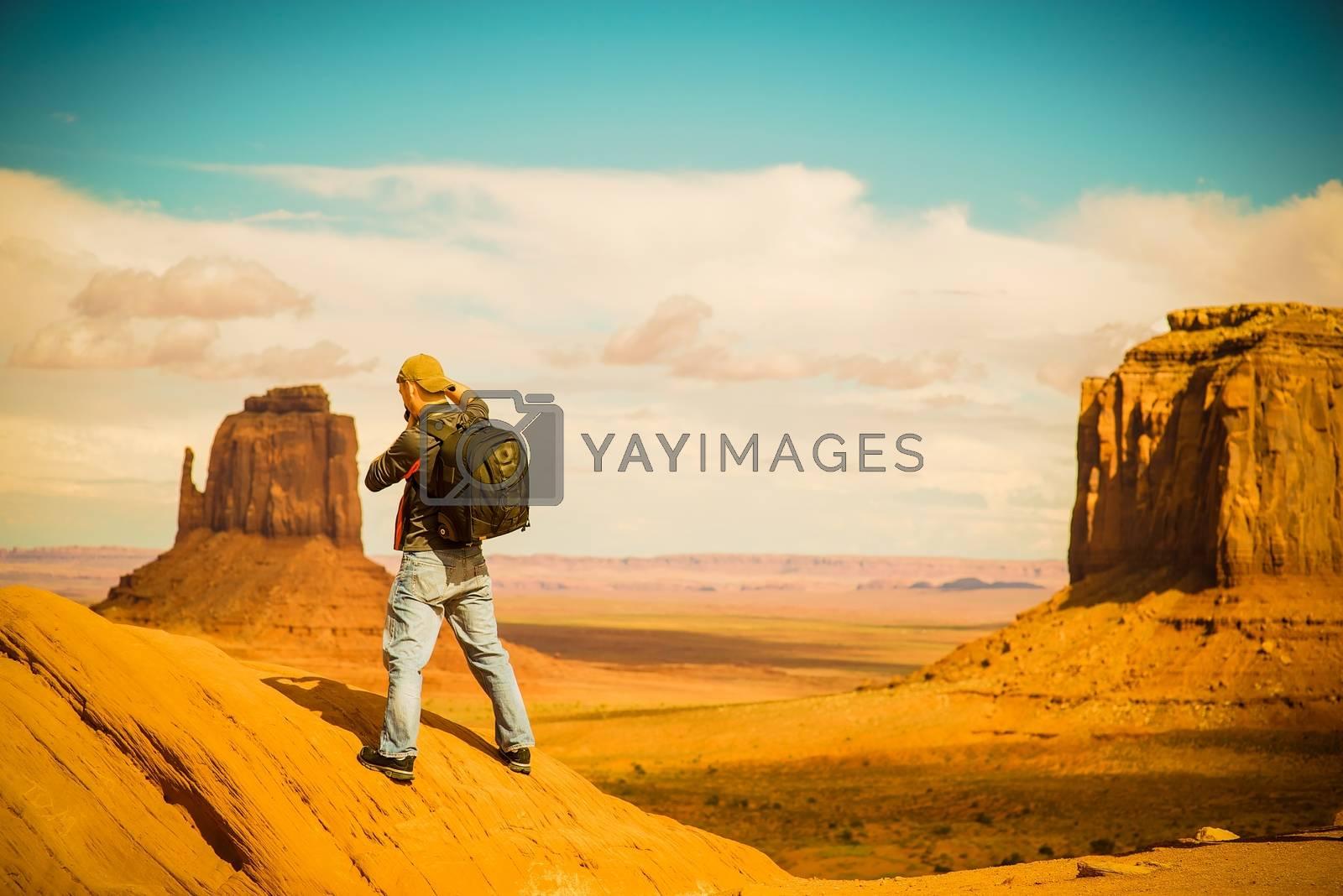Travel Photographer at Work. Arizona Monuments Valley. Male Photographer.