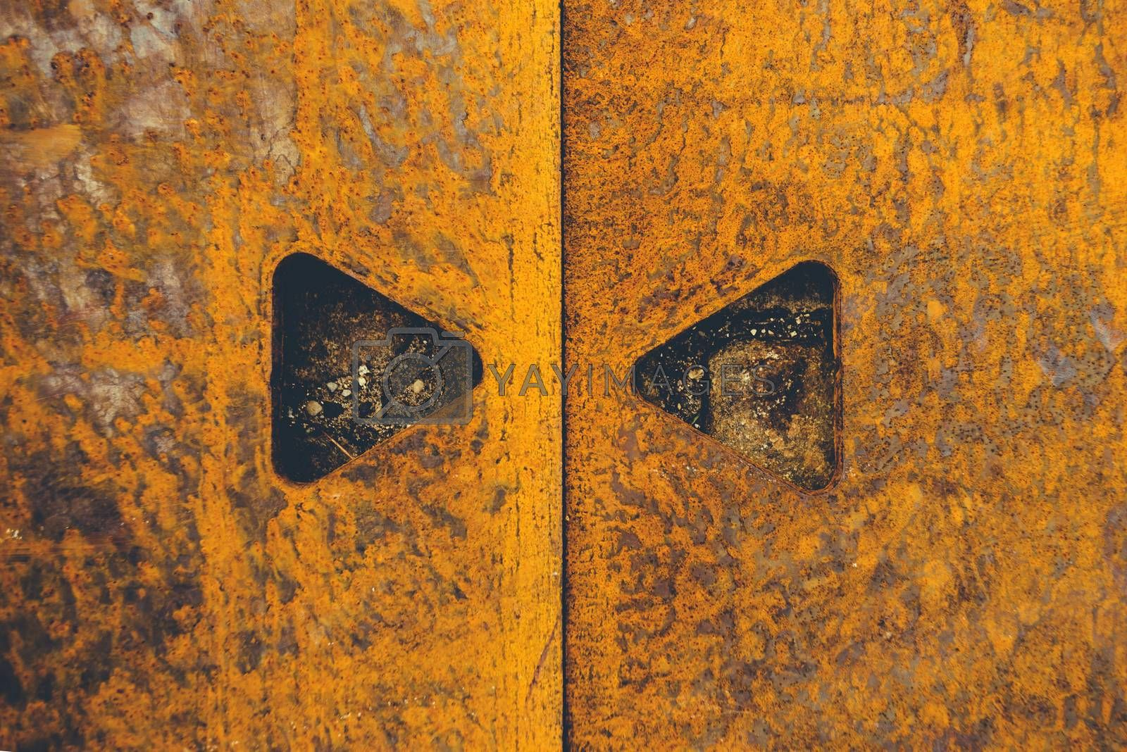 Rusty metal plate texture with triangular shape cut holes