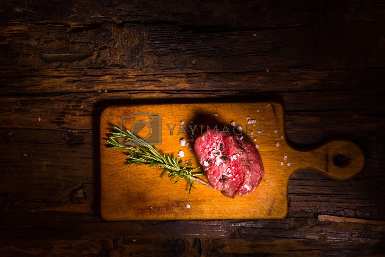 Royalty free image of Raw beef steak by sarymsakov