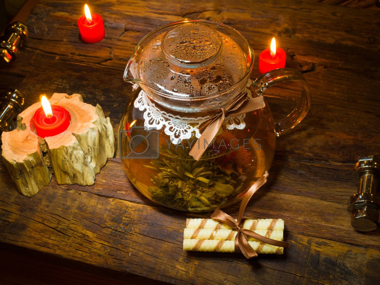 Royalty free image of exotic green tea with flowers in glass teapot  by sarymsakov