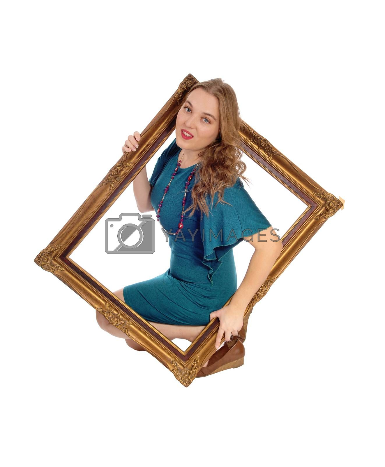Woman looking trough picture frame. by feierabend