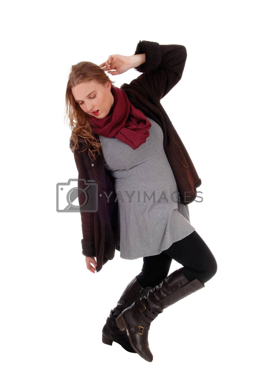 Royalty free image of Lovely woman in winter coat dancing. by feierabend