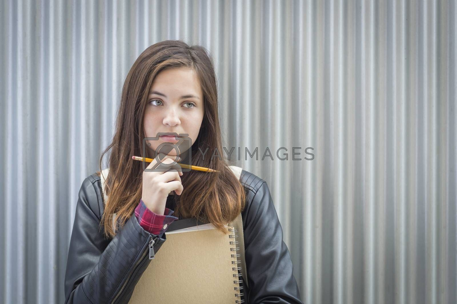 Royalty free image of Young Melancholy Female Student With Books Looking to the Side by Feverpitched