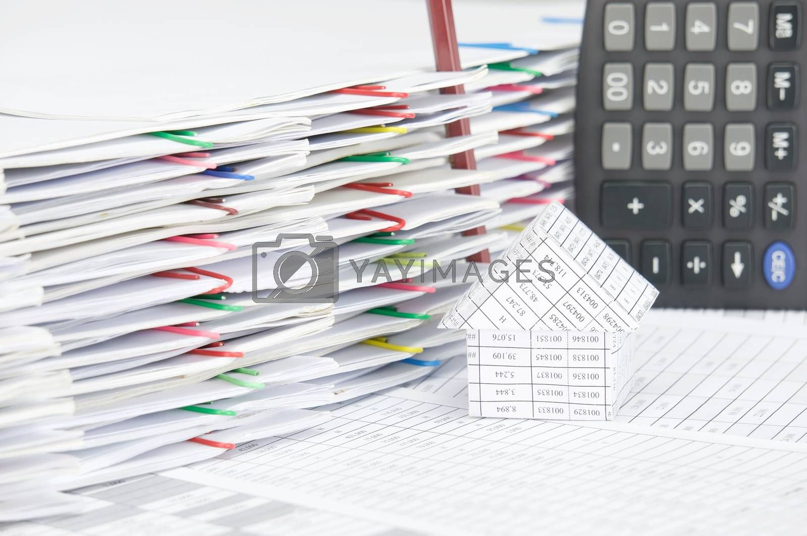 Royalty free image of House with brown pencil place vertical on finance account by eaglesky