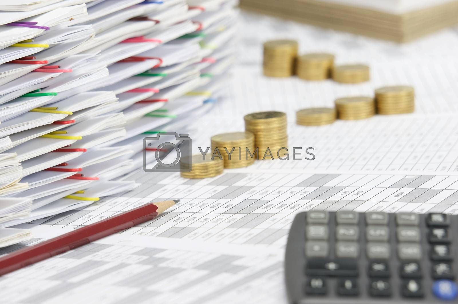 Royalty free image of Pencil have blur calculator and step pile of gold coins by eaglesky