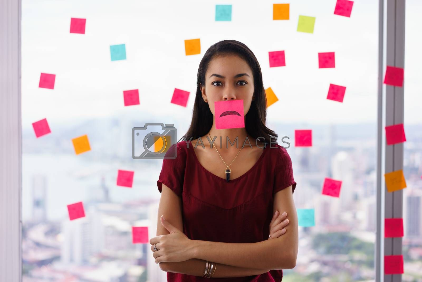 Royalty free image of Busy Person Holds Sticky Note On Mouth With Emoticon by diego_cervo