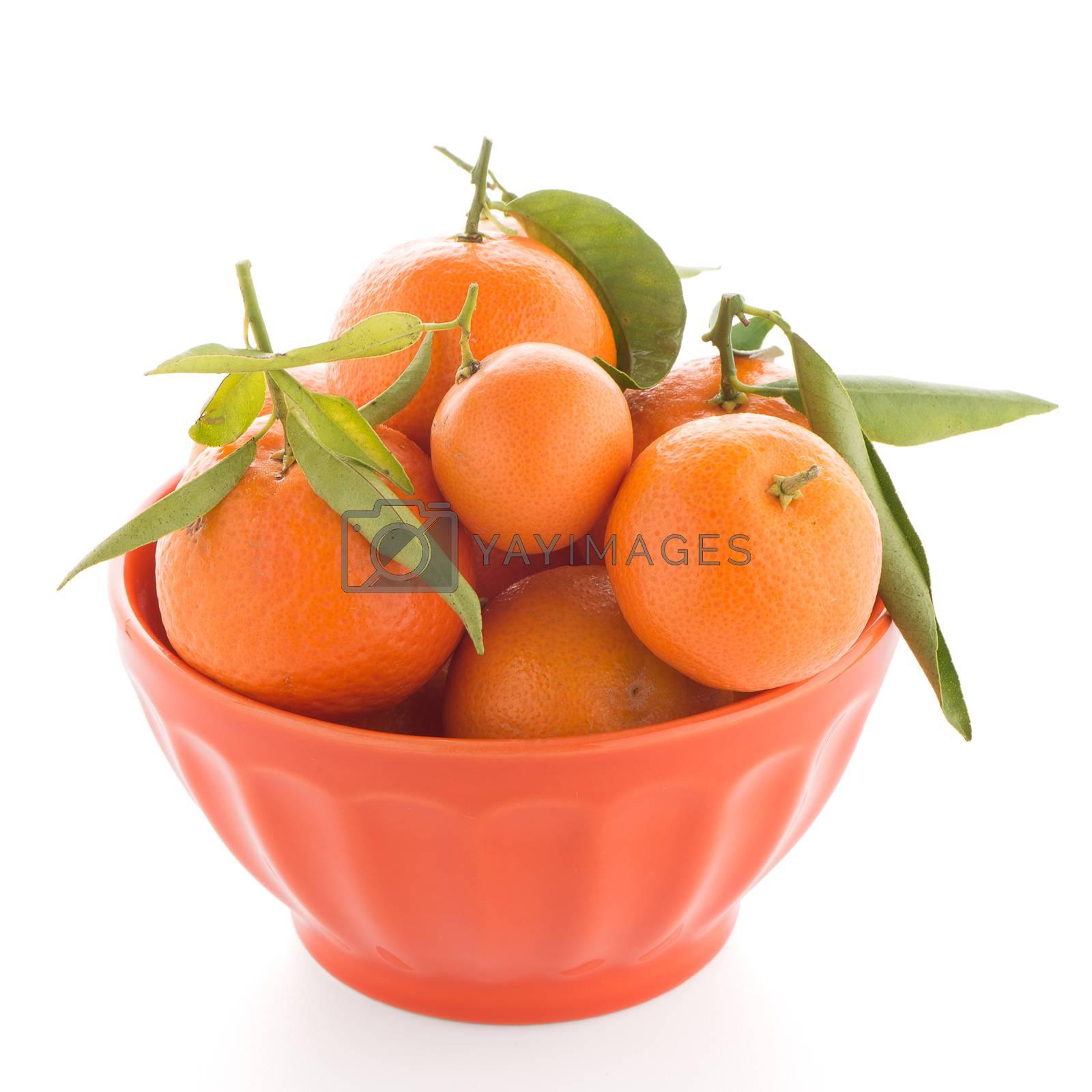 Royalty free image of Tangerines on ceramic orange bowl  by homydesign