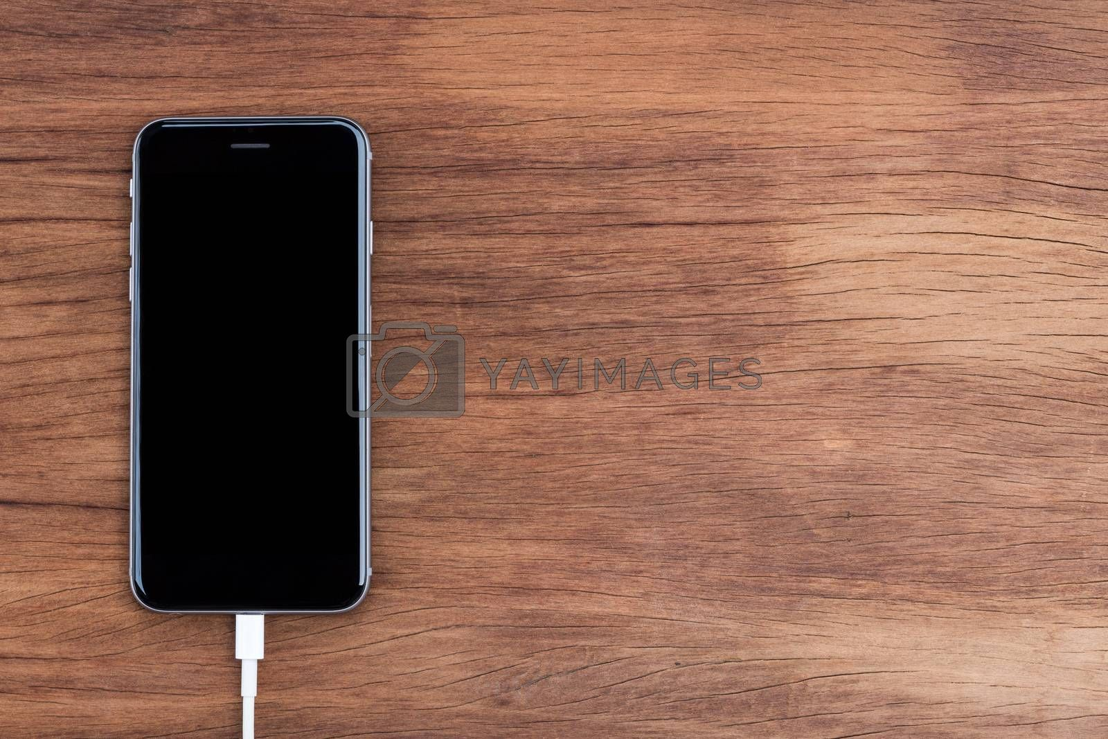 Royalty free image of usb data connect to phone on top view by blackzheep