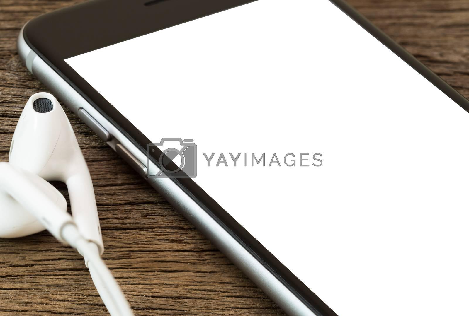close upphone white screen on wood table