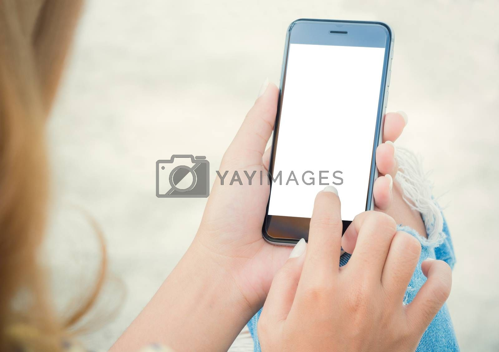 Royalty free image of closeup women using phone from back view by blackzheep