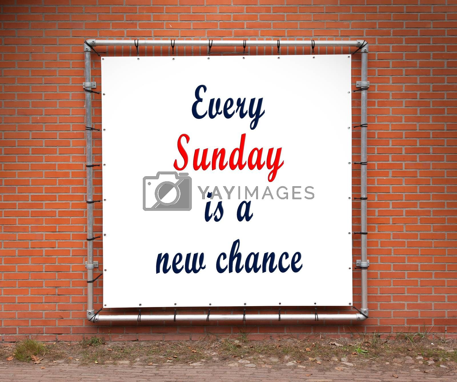 Royalty free image of Large banner with inspirational quote on a brick wall by michaklootwijk